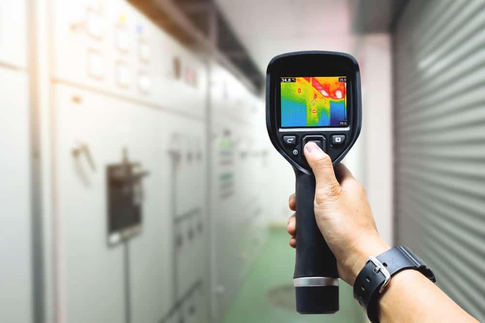 technician use thermal imaging camera check temperature factory